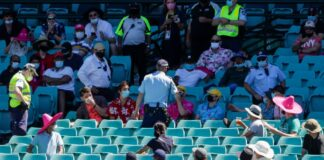 NSW police taking the six spectators out of the park